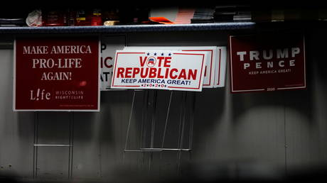 Yard signs inside the Republican Party of Eau Claire County office during a MAGA meet up presidential debate watch party in Altoona, Wisconsin, U.S., October 22, 2020