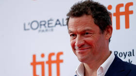 Actor Dominic West GLOATS about Trump's Covid-19 test to host whose husband fell into coma with virus