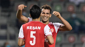 Iranian footballer hit with 6-month ban for 'eye-slant' celebration in Asian clash but star insists gesture is tribute to nephew
