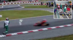 'What on Earth is he doing?' Karting ace stuns fans by HURLING BUMPER at cars in 'absolutely unacceptable' attack on track (VIDEO)