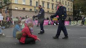 'Shame on you Finland! How dare you!' Outrage as Helsinki police PEPPER SPRAY sitting XR protesters