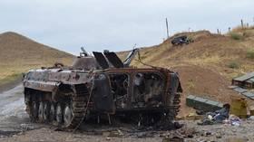 Azerbaijan celebrates partial retreat of Nagorno-Karabakh forces but Armenia says it was a 'trick' that killed 200 Azeris.