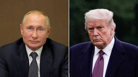 The real 'useful idiots'? Putin says Trump opponents using 'Russia card' to damage US president are playing into Moscow's hands