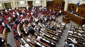 EU says ruling Ukrainian party 'knee-deep' in corruption: MEPs threaten Kiev with cuts to financial aid & visa-free travel