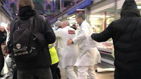 WATCH: Butchers chase animal rights activists out of London meat market