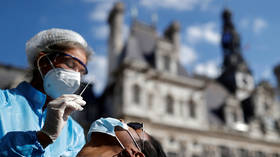 Public health state of emergency declared in France over Covid, as Macron confirms city curfews