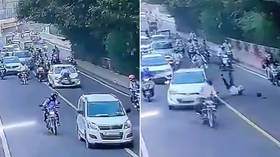 WATCH: Indian policeman DRAGGED on hood of moving car for 400 meters after trying to stop driver