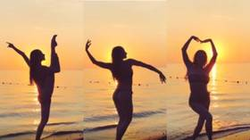 Swaying in the sunset: Russian synchronized swimming beauty Vlada Chigireva delights fans with bikini dance (VIDEO)
