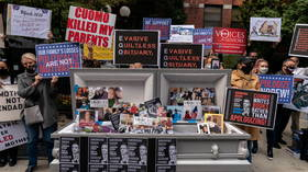 'Cuomo killed my parents': Protesters fill casket with copies of New York Governor's book on his Covid-19 response 'leadership'