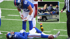 KNOCKED OUT: NFL player SLUMPS to the ground after taking hit before being carted out of game with 'scary neck injury' (VIDEO)