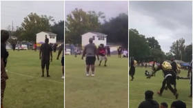 Families run for their lives as father is killed in front of his son in shooting at youth football game in the US (VIDEO)
