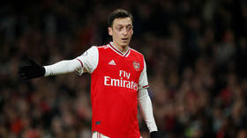 'He's getting paid £350K a week just to predict the scores': Arsenal outcast Ozil goes on tweet spree during Gunners game