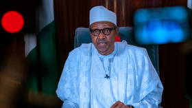 Nigerian president appeals for 'calm' after soldiers fire on protesters amid chaos in the capital