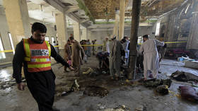 Bomb goes off at religious school in Pakistan, health officials report at least 7 killed & over 80 injured, including children