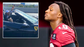 'You're a piece of TRASH': NFL star DeAndre Hopkins DENIES risking lives while INSULTING Donald Trump supporters from FERRARI