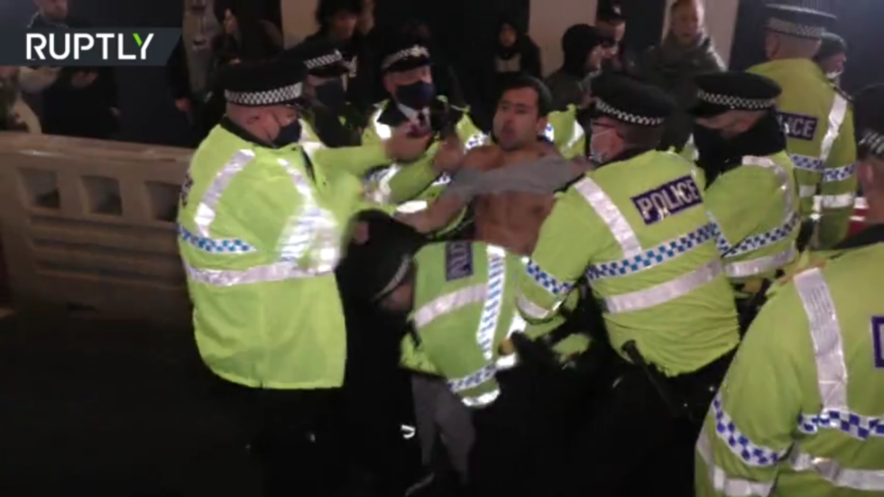 Covid-19 lockdown unrest: Liverpool protesters clash with police and Manchester students tear down 'prison-like' fencing (VIDEOS)
