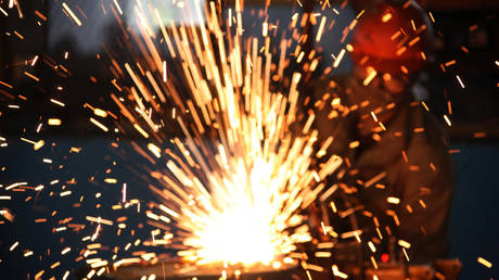 A worker welds steel in a factory in Huaibei, in north China's Anhui province