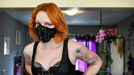 FILE PHOTO: Sex worker wears a mask in Netherlands