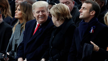 French President Emmanuel Macron, German Chancellor Angela Merkel, U.S. President Donald Trump and first lady Melania Trump. Paris, France, November 11, 2018 © REUTERS/Benoit Tessier/Pool