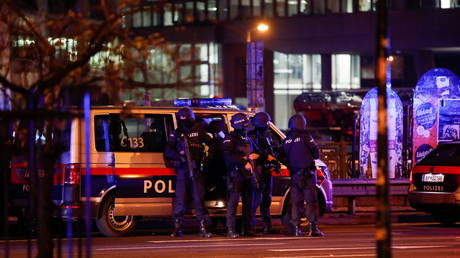 Police officers stand guard on a street after exchanges of gunfire in Vienna, Austria November 3, 2020.