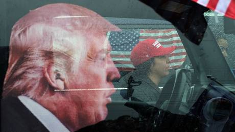 Participant of a rally in support of Donald Trump gathered in the parking lot of the Palisades Center in the suburbs of New York.