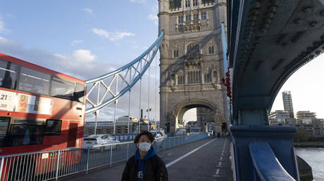 As Londoners await the second coronavirus national lockdown people still come to visit the sights such as Tower Bridge, some wearing face masks and some not, on what will be the last few days of normality before a month-long total lockdown in the UK on 2nd November 2020 in London, United Kingdom.