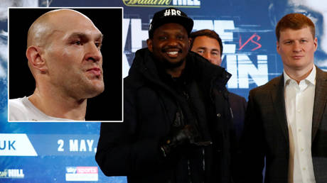 Eddie Hearn (second from right) says Tyson Fury (left) could fight Dillian Whyte (second from left) after Alexander Povetkin tested positive for Covid-19 © Steve Marcus / Action Images via Reuters | © Jason Cairnduff / Reuters