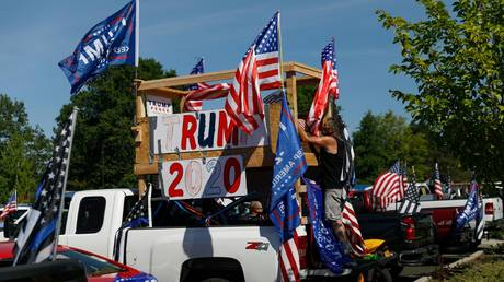 Hundreds of pickup trucks and cars full of flag-waving Donald Trump supporters gather for a âcruise rally❠at Oregon Community College in Clackamas, United States on September 07, 2020