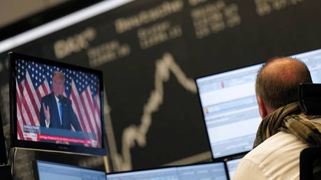 U.S. President Donald Trump is seen on a TV screen as the German share price index DAX reacts to the 2020 U.S. presidential election at the stock exchange in Frankfurt, Germany, November 4, 2020