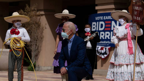 Democratic presidential candidate Joe Biden poses with supporters after speaking at the East Las Vegas Community Center about the effects of Covid-19 on Latinos, October 9, 2020, in Las Vegas, Nevada.