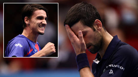 Tennis world number one Novak Djokovic (right) lost to Lorenzo Sonego (left) after the death of Serbian church leader Anfilohije Radovic © Lisi Niesner / Reuters