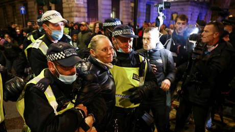 Arrests & scuffles as Million Mask March staged in London despite Covid-19 lockdown