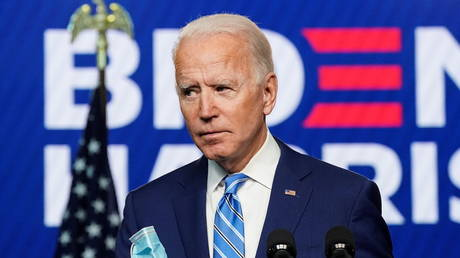 Democratic U.S. presidential nominee Joe Biden holds his face mask after speaking about the 2020 U.S. presidential election results during an appearance in Wilmington, Delaware, U.S., November 4, 2020.