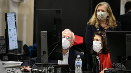 Members of an adjudication review panel look over scanned absentee ballots at the Fulton County Election Preparation Center on November 4, 2020 in Atlanta, Georgia.