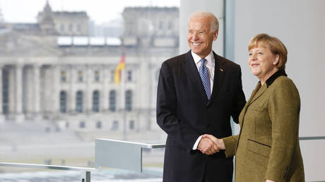 FILE PHOTO: Angela Merkel and Joe Biden shake hands before talks in Berlin, Germany, February 1, 2013 © Reuters / Tobias Schwarz