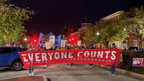 FILE PHOTO: Activists march along State Street in front of the Pennsylvania State Capitol Building to protest attempts to halt the counting of ballots cast in the state for the 2020 presidential election, in Harrisburg, Pennsylvania November 4, 2020