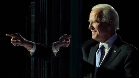 FILE PHOTO: President-elect Joe Biden points a finger at his election rally in Wilmington, Delaware, November 7