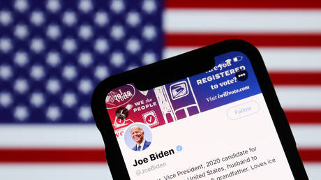 FILE PHOTO: Twitter feed of candidate for President of the USA Joe Biden is seen displayed on a phone screen with American flag in the background in this illustration photo taken on October 18, 2020