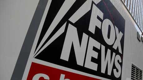 A Fox News channel sign is seen on a television vehicle outside the News Corporation building in New York City
