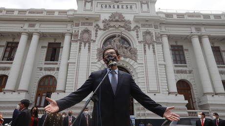Peru's President Martin Vizcarra addresses the media outside Congress as he faces a second impeachment trial over corruption allegations, in Lima, Peru, November 9, 2020