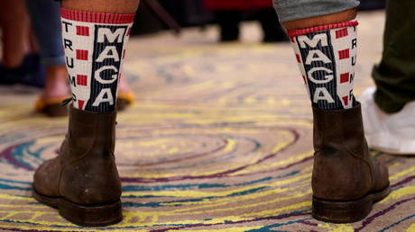 A supporter of U.S. President Donald Trump wears MAGA socks at the Oklahoma GOP watch party for the 2020 U.S. presidential election in Edmond, Oklahoma, U.S., November 3, 2020