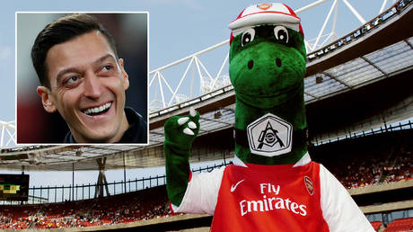 Mesut Ozil has saluted the return of Arsenal mascot Gunnersaurus at the Emirates Stadium © Eddie Keogh / Reuters   © Action Images / Tony O'Brien