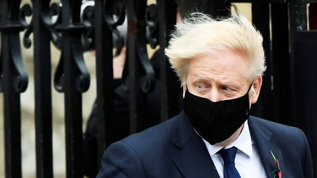 Britain's Prime Minister Boris Johnson wearing a face mask leaves the Westminster Abbey following a remembrance service on Armistice Day in London, Britain, November 11, 2020