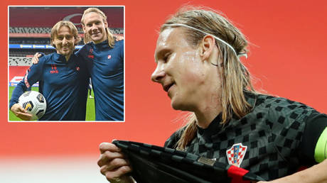 'He touched the ENTIRE Turkish team': Fans hit out as Croatia star Vida is hauled off at half-time over positive Covid test