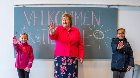 FILE PHOTO. Norway's Prime Minister Erna Solberg visits the Ellingsrudasen school in Oslo. ©NTB Scanpix via REUTERS / Hakon Mosvold Larsen