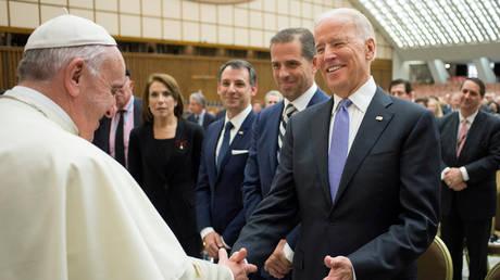 FILE PHOTO: Then-US Vice President Joe Biden meets Pope Francis at the Vatican, April 29, 2016