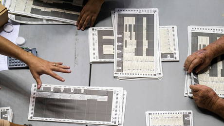 Election workers in San Juan, Puerto Rico, count local election ballots found 'forgotten' in 180 briefcases in a warehouse, November 11, 2020.