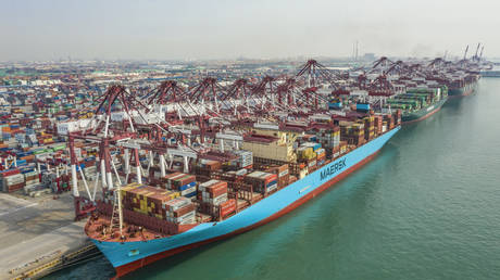 A cargo ship berthing at a port in Qingdao in China's eastern Shandong province