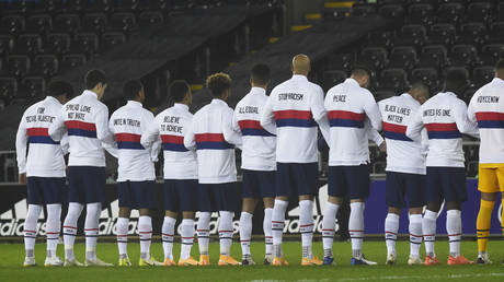 US players lined up with message on their jackets before the game with Wales. © Action Images via Reuters
