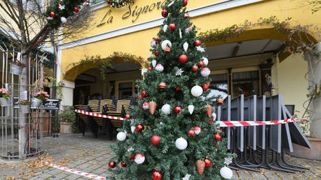 A decorated Christmas tree is seen in front of a closed restaurant in Ludwigsburg, southern Germany on November 11, 2020.